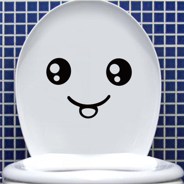 Playful smiling toilet sticker